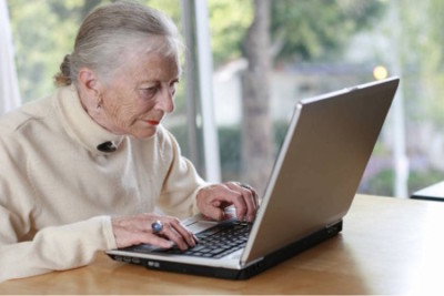 woman-over-50-on-a-computer